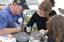 The Learn to Solder tent is always a big hit, especially when our [Robot Pin](http://www.makershed.com/Learn_to_Solder_Skill_Badge_Kit_p/mkls01.htm) is involved.