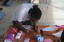 Learning To Solder supercapacitor flashlight kits from Jaycon Systems at Miami Mini Maker Faire 2013