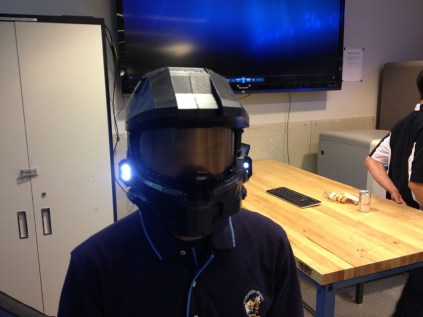 Chad Ramey shows off his Spartan helmet, which was 3d printed and assembled together.