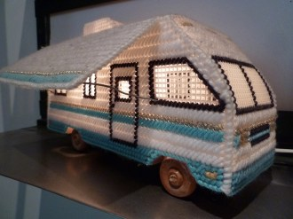 We don't know when this amazing plastic canvas needlepoint RV lamp was made, but our own Laura Cochrane spotted this gem in early 2013 and it lit the way for a lot of crafty brilliance this year!