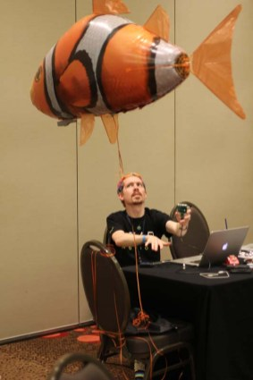 Alan from Leap Motion controlling a flying fish with a Leap Motion controller.