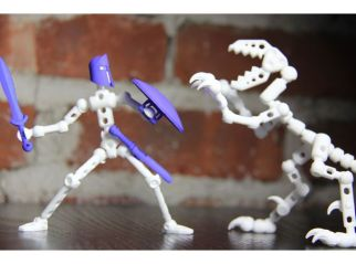 """The ModiRaptor is the scourge of the ModiBot universe and is comprised of 47 3D printed parts. It has a highly articulated tail and body, vice-like jaws and 12 moving claws. ModiBot Mo (and Moli) are highly poseable action figures the you can customize with a variety of unique accessory packs to make your own.Check out ModiBot.com. for the full collection. Also available in injected molded and """"print your own"""" versions. Build your hero!"""