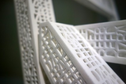 The chair's structure is a code, which if scanned with the correct decoder would tell a computer, 'chair.'