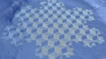Simon Beck's amazing math-inspired large-scale snowshoe art.