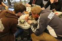 """Paweł Szymczykowski led the """"Build a Bot"""" workshop by teaching attendees to build one of his SumoBot Jr kits."""