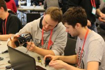 """The """"Dancebot"""" workshop was crowded with makers wanting to build these 3D printed dancing robots."""