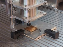 You'll need a method for finding and setting the exact x, y, and z position of your spindle with respect to your stock at the beginning of each job. There are various techniques for handling this difficult challenge, such as edge finders, lasers, and z-axis dial gauges, but here's how we do it. Photo: Beatty Robotics