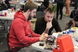 Jon (@jonmarkgo) & Swift (@SwiftAlphaOne) working intently on their SumoBot.