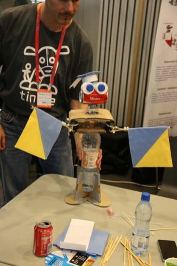 This cute robot with an ominous name uses signal flags to say hello.