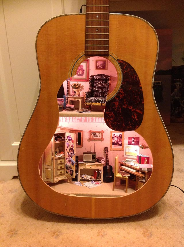 A Doll House Made From An Old Guitar