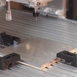 One of the biggest challenges of using a CNC is holding the stock in place. Much of your time and thought will be consumed by that subject. A t-slot table is great, but you need to invest in t-slot nuts, step clamps, step blocks, and other fixtures that fit your particular table. Nuts and studs are often sold with these kits, but we find these frustrating to use. Instead, we use a handled hex driver and a collection of socket head cap screws of various lengths. Photo: Beatty Robotics