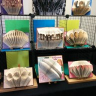 Marlene Reid of IslandGirlzDesigns turns old books into works of art by handfolding each page.