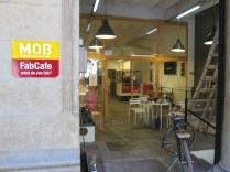 In town: FabCafe - note the red laser cutter there in a cage near the espresso bar