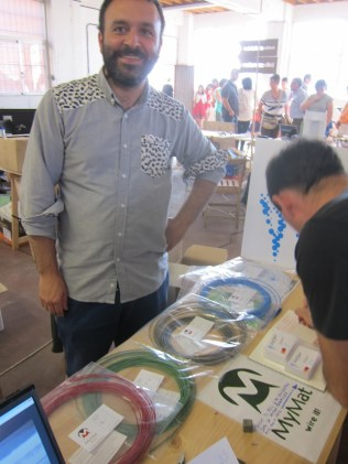 Josu from Leartiker (a polymer R&D division of Mondragan, the Basque manufacturing cooperative) showing their brand new nylon multi-color filaments, as well as glass and wood particulate filaments