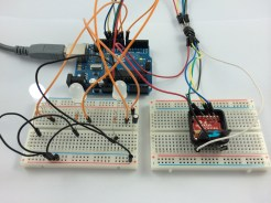 The AVR Programmer powered up, and attached to the MicroView