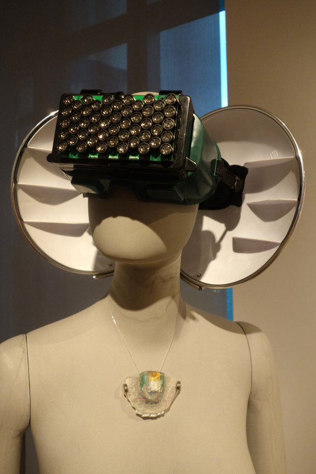 Echolocation Headphones (on head) and Play-A-Grill (around neck) by Aisen Caro Chacin