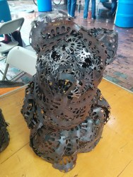 """Ted McAuliffe uses """"electric motor innards"""" to fabricate these 'woven' (not welded) lamp enclosures."""
