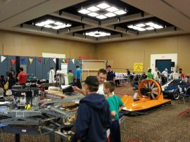 """""""GarageOfTheFuture"""": Is this the garage of the future? From left to right in this photo, attendees saw a gas-powered quadcopter designed to lift a human-size load built by Peter McCloud, a personal hovercraft built by Ben King and an electric car with solar-power assist built by a team of Rice University students."""