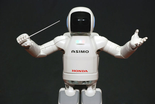ASIMO putting his Conductor skills to good use.
