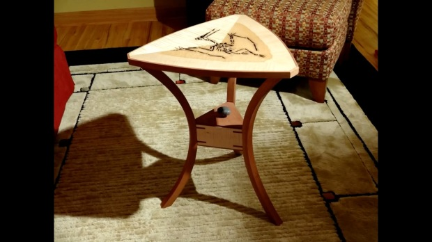 Though the fossil isn't real, Andrew Klein's table is still an exceptional piece of work.