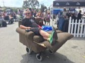 All manner of motorized chairs and couches have been seen at Faires over the years, this one at MFBA 2014. Photo by John Biehler.