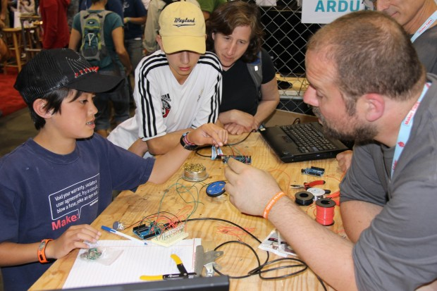 Quin gets hands-on Arduino help from The Man himself, Massimo Banzi.