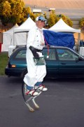"""Give people """"permission to play"""" and you end up with a guy in a white jump suit on jumping stilt thingies with contraptions on his head. But hey, in the immortal words of William Blake, """"The road of excess leads to the palace of wisdom."""" From the 2010 MFBA. Photo by Blake Maloof."""