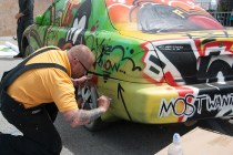 Beautiful but doomed, the Pittsburgh Art Car gets finishing touches from artist Jason Sauers before its inevitable destruction by the MegaBot this weekend.