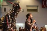 Kolja Kugler greets the crowd ahead of a performance of the One Love Machine Band.