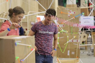 The Stawbees team have fun with their construction kit during a lull.