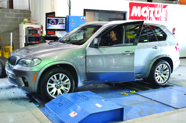 Hogarty tests changes to the ECU of an SUV as it sits on a dynamometer.