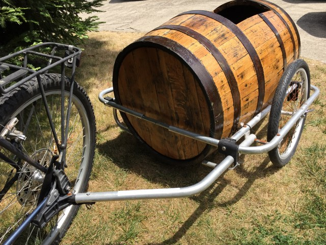 Stylishly Port a Passenger with this Wine Barrel Bike Trailer