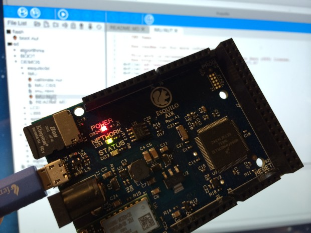 The Esquilo board in front of the onboard web-based development environment.
