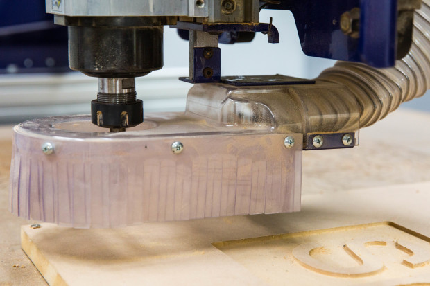 This skirt around the cutting bit allows a vacuum to be attached for dust collection.