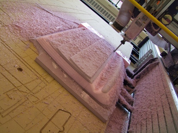 Using a CNC router to shape the large foam panels before coating them with fiberglass cloth and epoxy. The foam shapes were exported directly from the 3D model.
