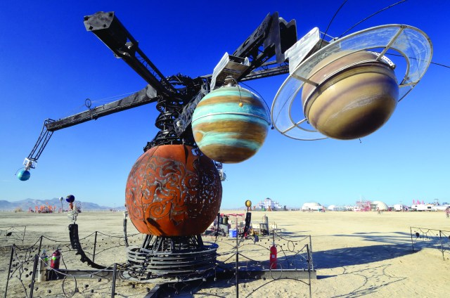 Watch the Fiery Rotations of a 40-Foot-Wide Mechanical Solar System