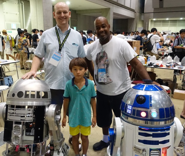 Jonathan Reinfelds and Richard Inoue share the work of building R2D2s.