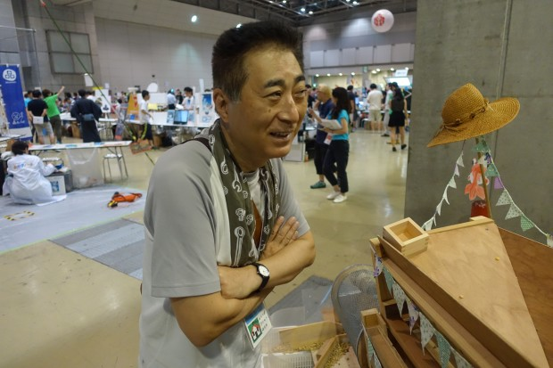 Akhira Sato created a wooden, hand-cranked sorter for soybeans.