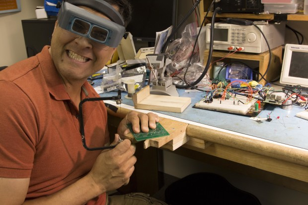 A happy Dave works away on his bench pin.