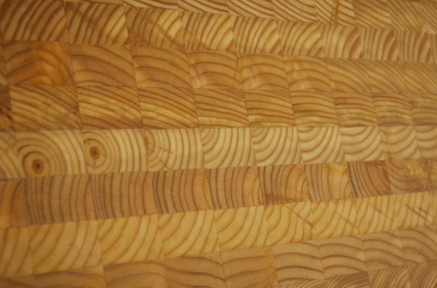 larch cutting board close up of end grain