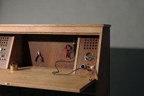 The electronics includes a temperature-controlled soldering station and voltmeter.