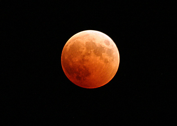Naval Air Station Whidbey Island, Wash. (Oct. 27, 2004) - The moon turns red and orange during a total lunar eclipse. With the Earth passing between the sun and the moon, the only light hitting the full moon was from the home planet's sunrises and sunsets, resulting in the orange and red hue. The next total lunar eclipse won't be till March 2007. U.S. Navy photo by Photographer's Mate 2nd Class Scott Taylor (RELEASED)