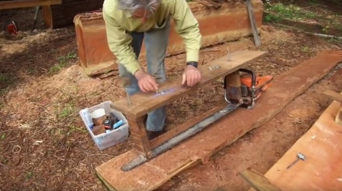 Turning a log into wood pile with simple alaskan mill