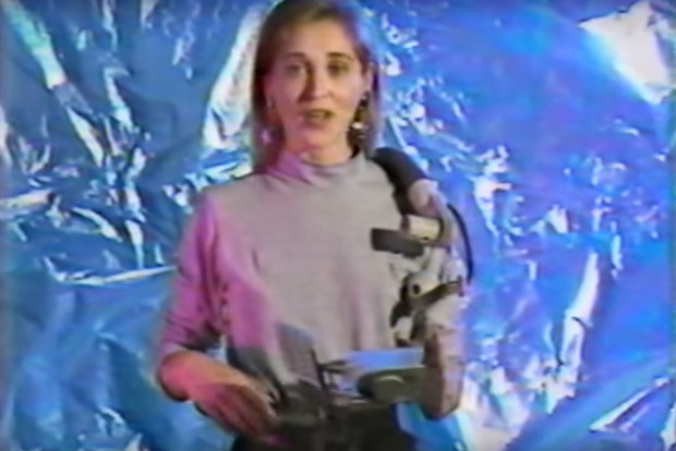 With an onboard camera, keyboard, telephone, and speech-to-text capabilities, she's basically wearing a smartphone.