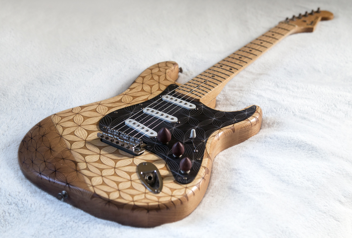 Bringing a Guitar Back to Life with Lasers