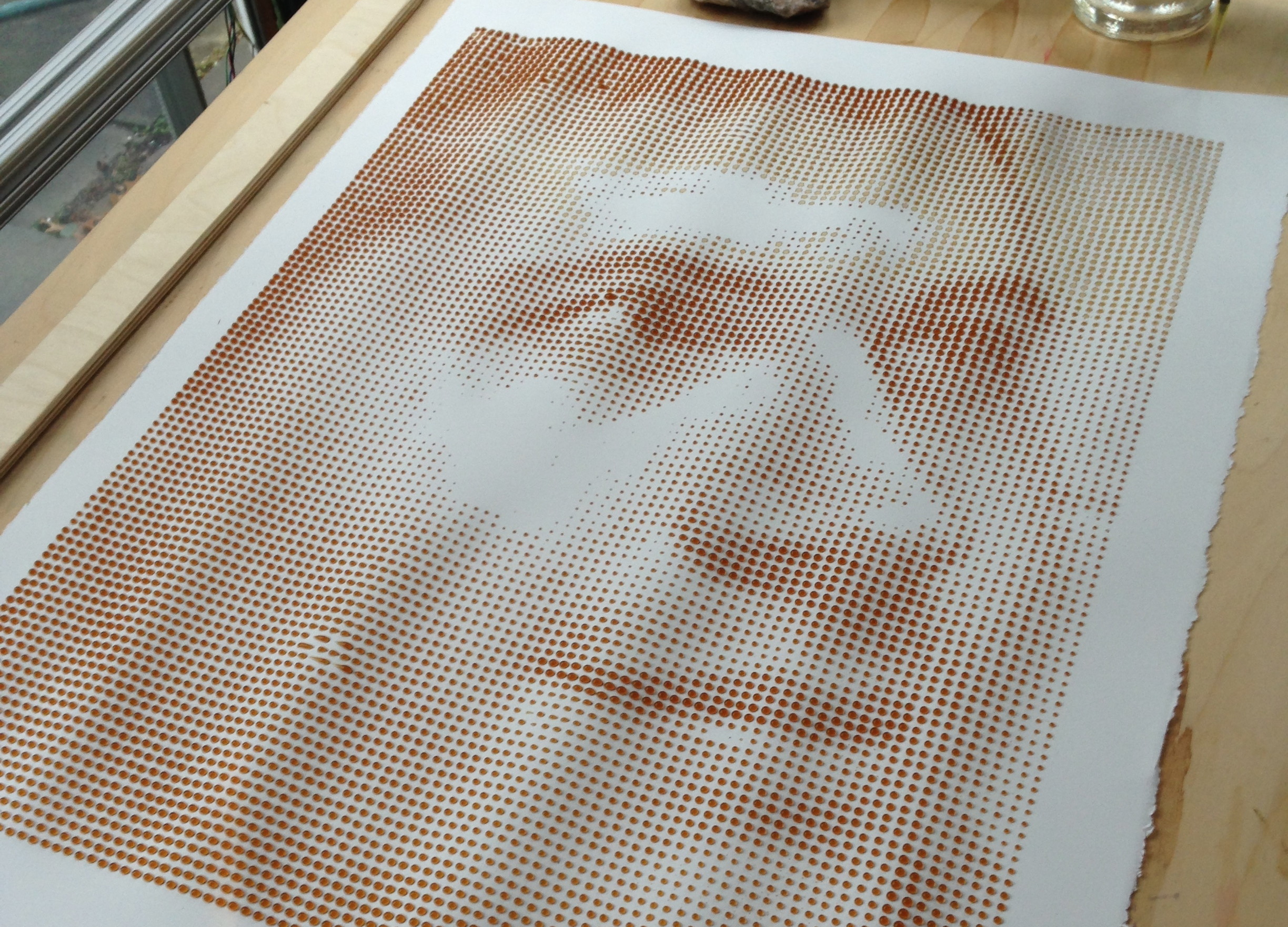 This Machine Prints Portraits with 8,000 Drops of Coffee
