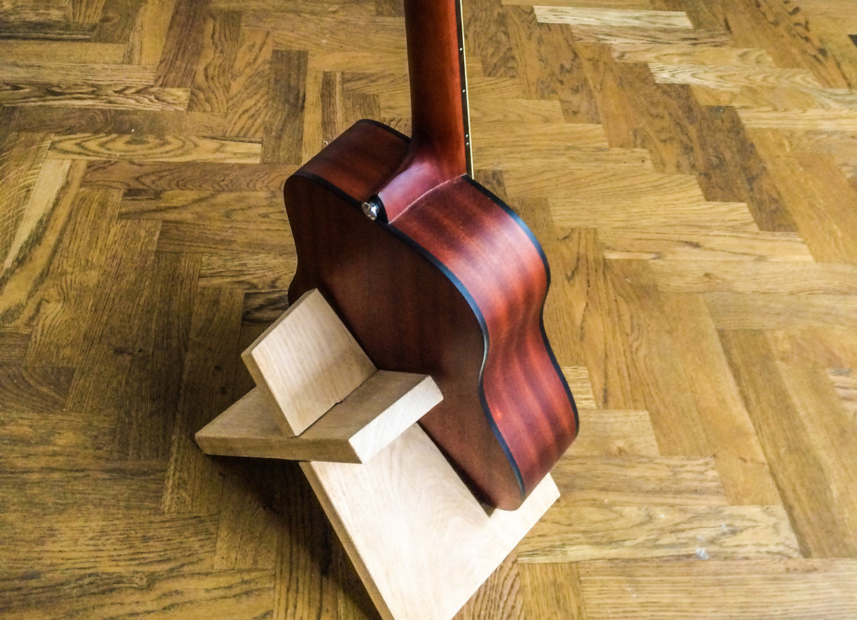 Build This Simple Guitar Stand From A Single Board Of Wood