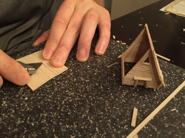 To make the roof look shingled, I cut lines into the wood at a shallow angle to make flaps.