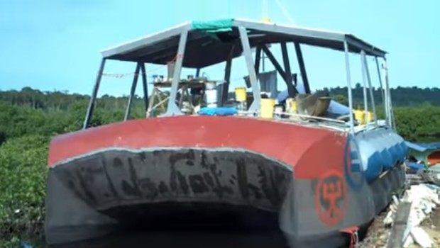 The house boat gets painted with left over paint from other projects.