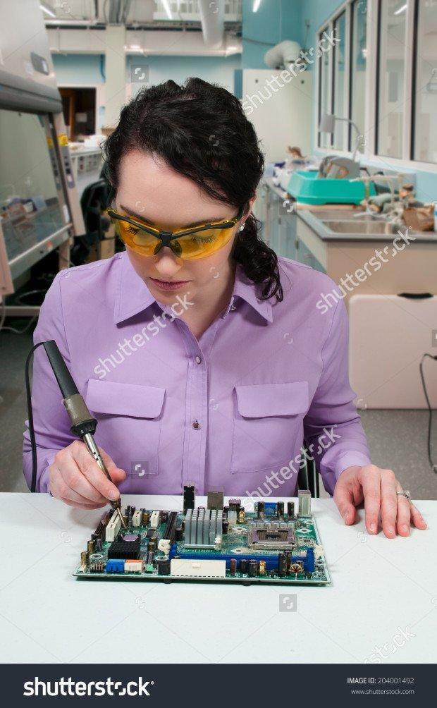 stock-photo-beautiful-woman-repair-soldering-a-printed-circuit-board-204001492